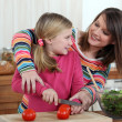 Mother cooking with daughter — Stock Photo