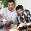 Man and boy playing to video games — Stock Photo #10502200