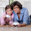 Mother and daughter playing video games — Stock Photo #10502349