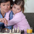 Grandmother playing chess — Stock Photo