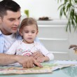 Father and daughter reading together — Stock Photo