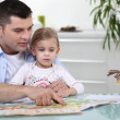 Father and daughter reading together — Stock Photo #10502588