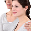 Mother embracing her daughter — Stock Photo #10502946