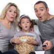 A nice family watching a movie. — Stock Photo