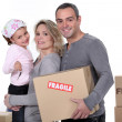 Young family moving house — Stock Photo