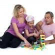 Family playing with building blocks — Stock Photo #10503196