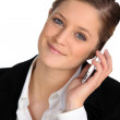 Blond woman with mobile phone — Stock Photo