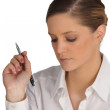 Serious woman with a pen in her hand — Stock Photo