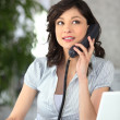 Stock Photo: Receptionist answering telephone
