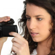 Woman holding a camcorder — Stock Photo #10505839