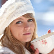 Woman drinking hot mug of coffee on a winters day — Stock Photo