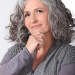 Stock Photo: Pensive middle-aged woman