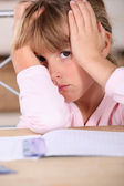 Girl tired of doing homework — Stock Photo