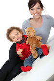 Mom with baby and teddy bear — Stock Photo