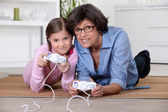 Mother and daughter playing video games — Stock Photo