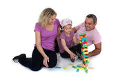 Parents stacking bricks with their daughter — Stock Photo
