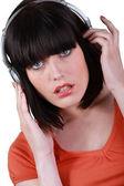 A woman listening music — Stock Photo