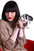 Trendy woman with pairs of eyeglasses — Stock Photo