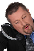 Moon-faced man losing headphones — Stock Photo