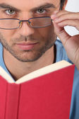 Man with glasses reading — Stock Photo