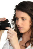 Woman holding a camcorder — Stock Photo