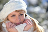 Woman snuggling up to her warm clothing — Stock Photo