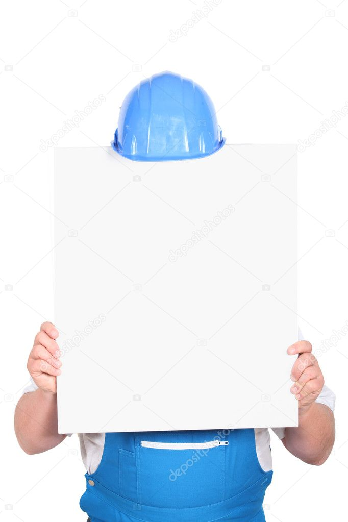 Construction worker with a board left blank for your message  Stock Photo #10505579