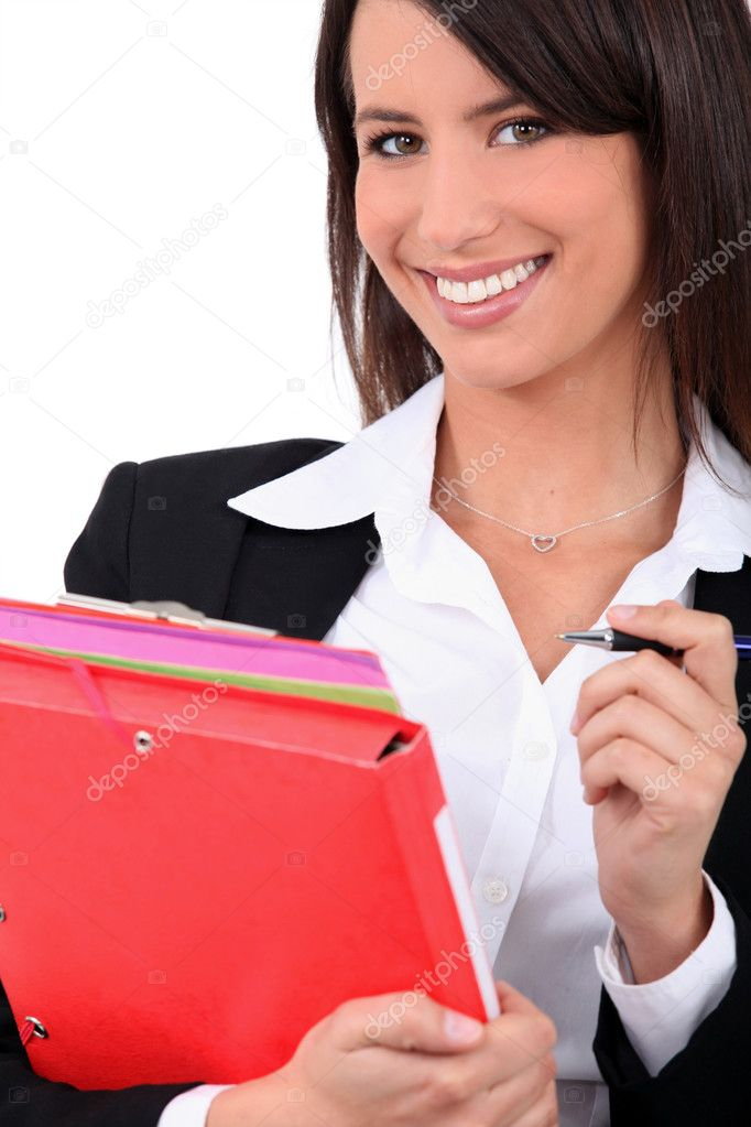 Young brunette with folders — Stock Photo #10507254