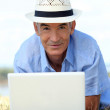 Man with computer — Stock Photo