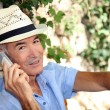 Elderly man with mobile phone — Stock Photo #10511596