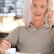 Retired man drinking coffee — Stock Photo #10511878