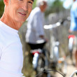 Senior man on a bicycle — Stock Photo #10512236