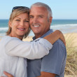 Senior couple on vacation embracing — Stock Photo #10512587