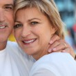 Mature couple embracing — Stock Photo #10512600