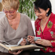 Stock Photo: Senior women with photo album