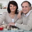 Couple playing chess together — Stock Photo #10515246