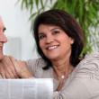 Senior couple reading the newspaper — Stock Photo