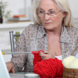 Stock Photo: Elderly womknitting