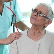 Nurse taking patient's heart rate — Stock Photo #10515825