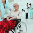 Nurse with elderly invalid — Stock Photo