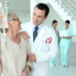 Doctor with senior woman in hospital — Stock Photo #10515866