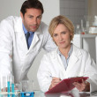 Man and woman in laboratory — Stock Photo #10516175