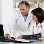 Two doctors examining x-ray — Stock Photo #10516860