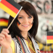 Germany supporter holding miniature flags — Stock Photo #10517287