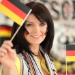 Royalty-Free Stock Photo: Germany supporter holding miniature flags