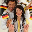 Overjoyed man and woman supporting Germany — Stock Photo #10517321