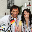 German couple supporting their national team — Zdjęcie stockowe