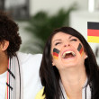 Couple supporting the German football team - Stock Photo