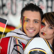 Couple supporting German football team - Stock Photo