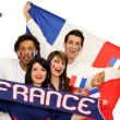 Cheerful men and women supporting France — Stock Photo #10517580